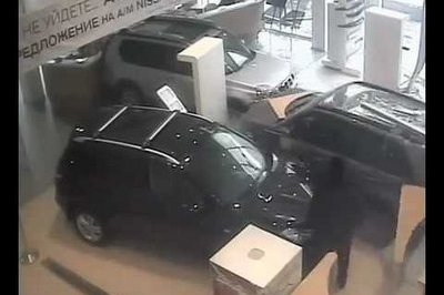 Video: Angry Customer Snaps and Drives his SUV into a Car Dealership