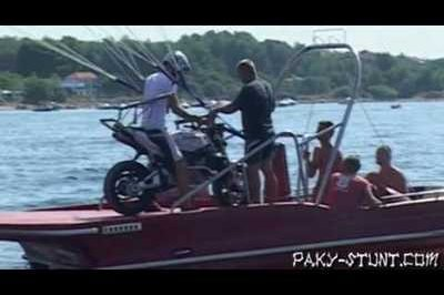 Motorcycle + parachute + speed boat = lots of fun