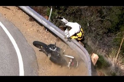 Video: Motorcycle highside ends with rider being thrown over guardrail