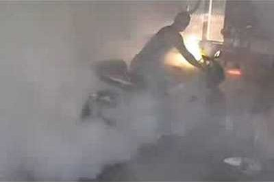 Can a motorcycle burnout determine neighbors to call the fire brigade?