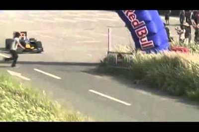 Video: Idiot fan jumps over Red Bull F1 race car