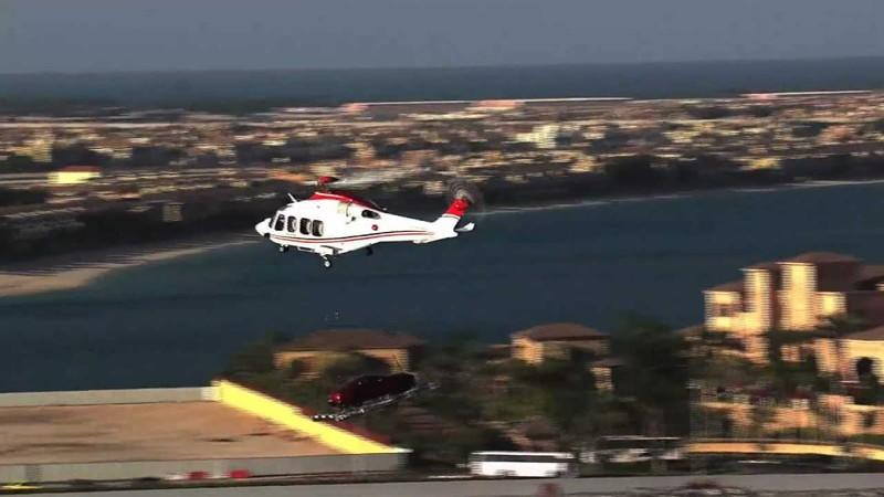 Video: Aston Martin Vanquish Gets a Helicopter Ride to the Top of Burj Al Arab