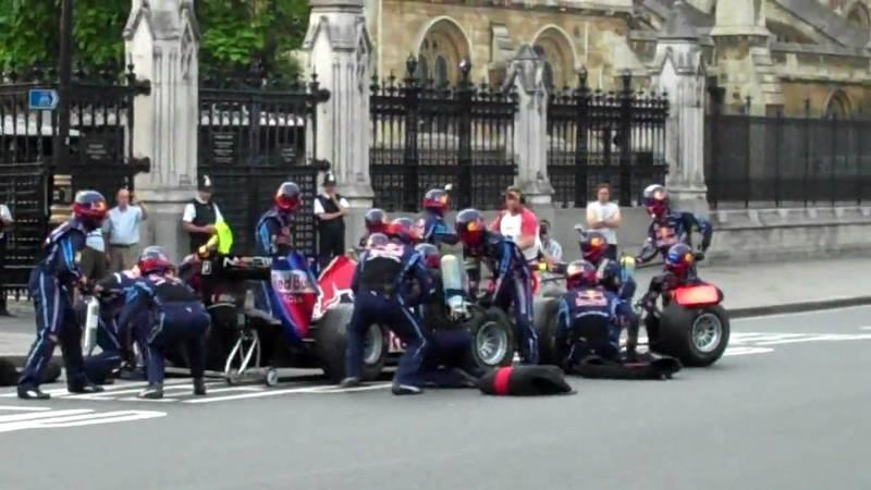 Mark Webber's Red Bull RB6 makes pit stop...in front of London's Parliament Square