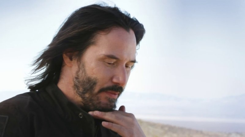 Keanu Reeves goes motorcycle surfing for a Super Bowl Ad