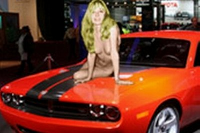 Woman poses naked atop the new Dodge concept car