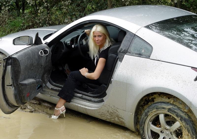 Nissan 350Z stuck in the mud by a blonde