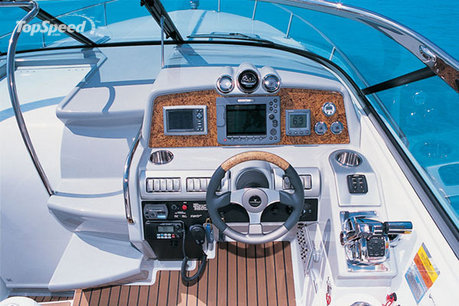 At the helm of the 350 Sun Sport is a twin command seating, adjustable for ...