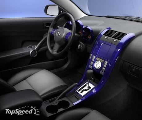 Custom two-tone leather interior with Ron English artwork embroidered in the