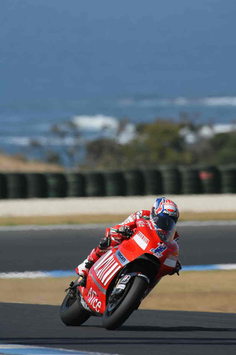 Stoner smashes Phillip Island record, Melandri signs off satisfied