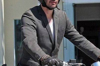 Is that Keanu Reeves riding a Norton motorcycle?