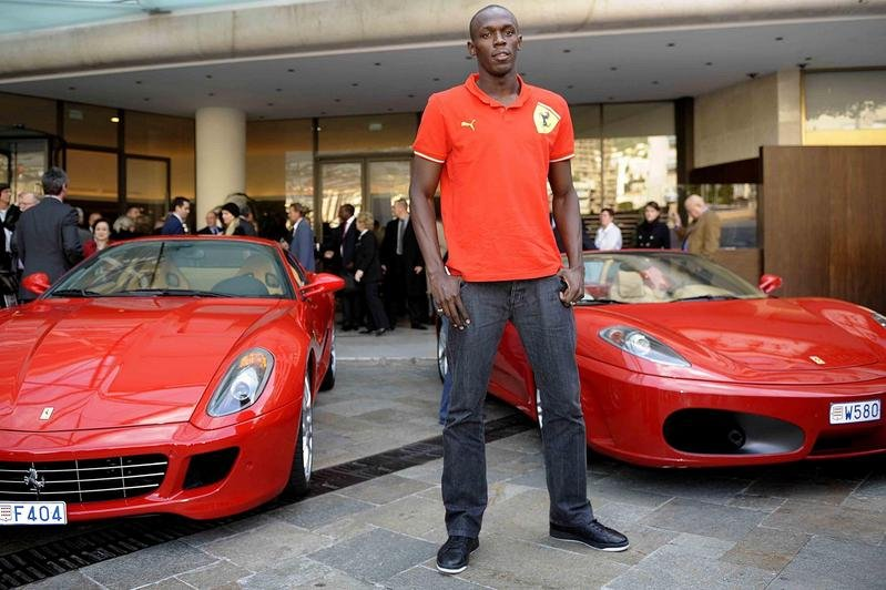 Usain Bolt Drives A Ferrari F430 Spider And BMW M3 Coupe