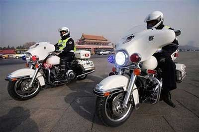 Three Beijing policeman made happy by Harley-Davidson