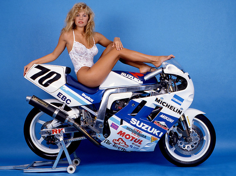 Young Pamela Anderson posing as Suzuki girl