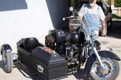 Motorcycle fitted with coffin sidecar…