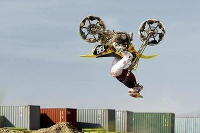 Travis Pastrana does backflip with the SHOE BIKE!