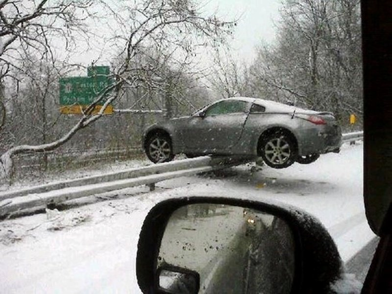 Road accident results in Nissan 350Z teetering on a guardrail