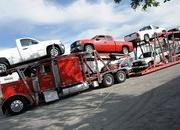 The GM Foundation sends relief to Haiti in the form of 30 Sierra pick up trucks - image 347400