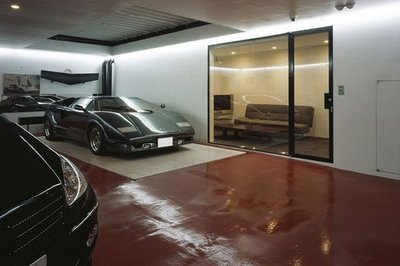 Lamborghini's inside a living room are insanely awesome