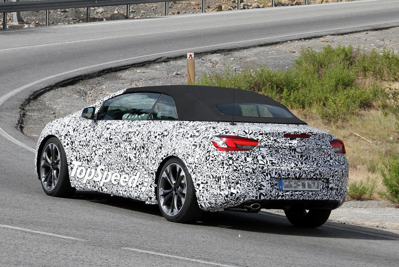 Spy Shots: Opel Astra Convertible loses some camouflage and shows off its soft top