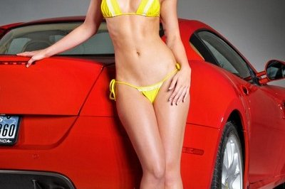 Caitlin Hixx flirts with a Ferrari 599 and an F430 Scuderia Spyder 16M