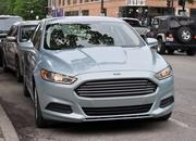 2014 Ford Fusion Hybrid - image 512573