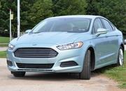 2014 Ford Fusion Hybrid - image 512559