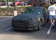 Spy Shots: 2015 Ford Mustang Caught in a Hotel Parking Lot - image 517814