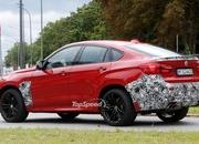 Spy Shots: BMW X6 M Slowly Losing Its Camouflage - image 566304