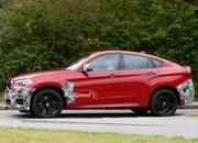 Spy Shots: BMW X6 M Slowly Losing Its Camouflage - image 566305