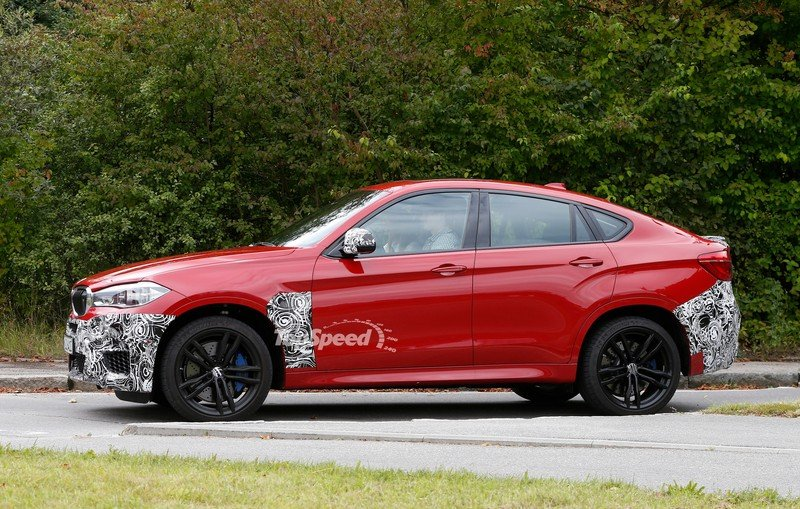 Spy Shots: BMW X6 M Slowly Losing Its Camouflage Exterior Spyshots - image 566305