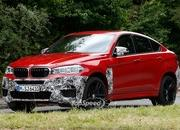 Spy Shots: BMW X6 M Slowly Losing Its Camouflage - image 566306