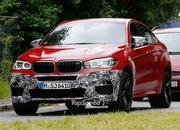 Spy Shots: BMW X6 M Slowly Losing Its Camouflage - image 566307