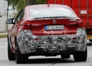 Spy Shots: BMW X6 M Slowly Losing Its Camouflage - image 566303