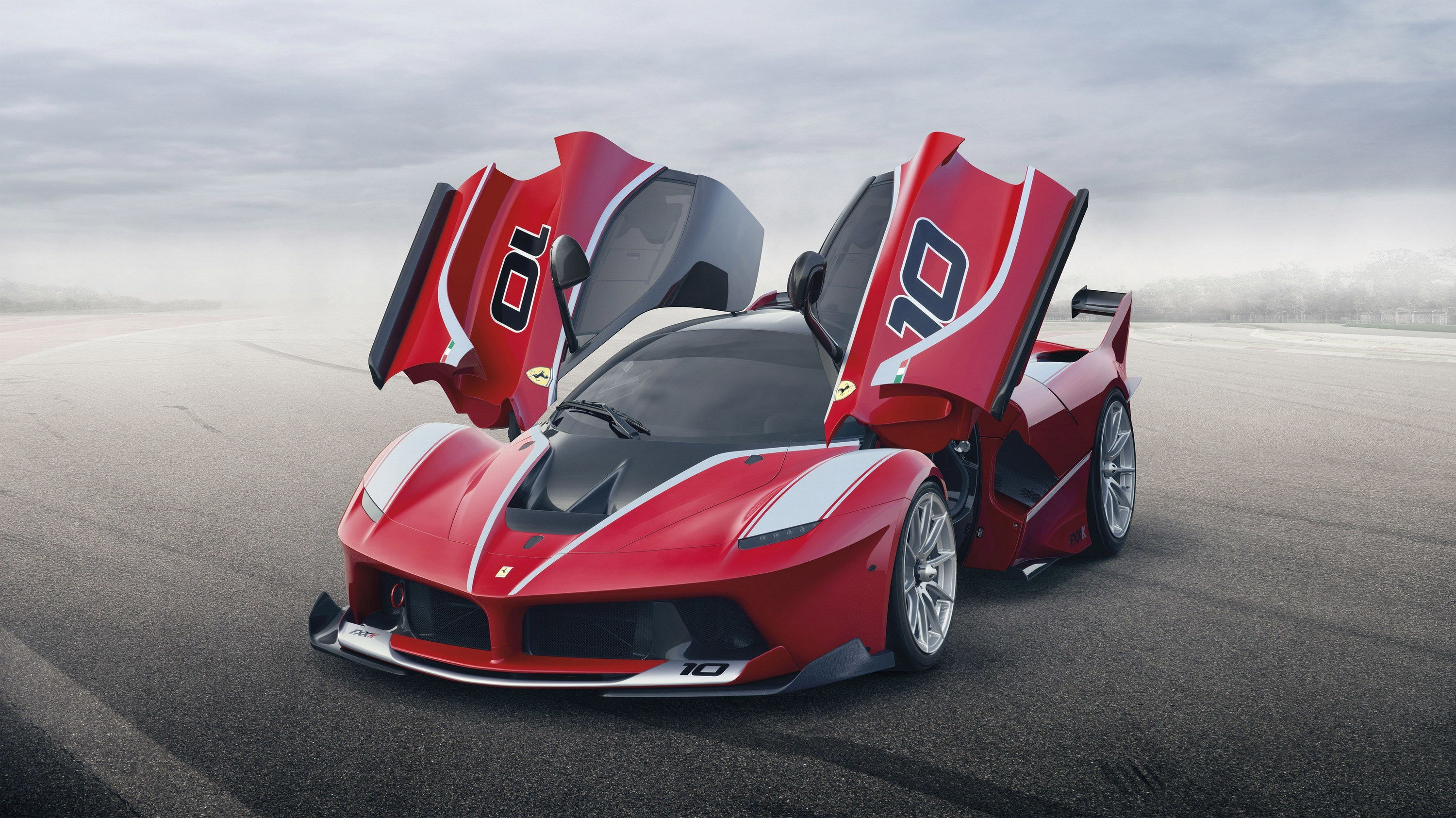 The Ferrari FXX K (AKA the track-only LaFerrari) has finally made its debut. Check out all of its hybrid supercar awesomeness at TopSpeed.com!