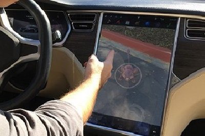 Did Someone Hack the Tesla Model S to Play Pokemon Go on the Go?