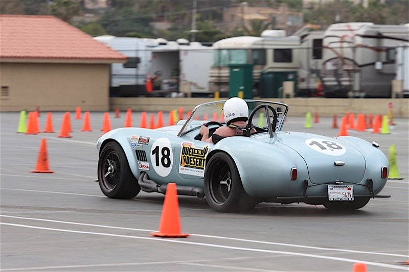 Watch this Mean Shelby Cobra 427 Flex its Muscles and Burn Rubber