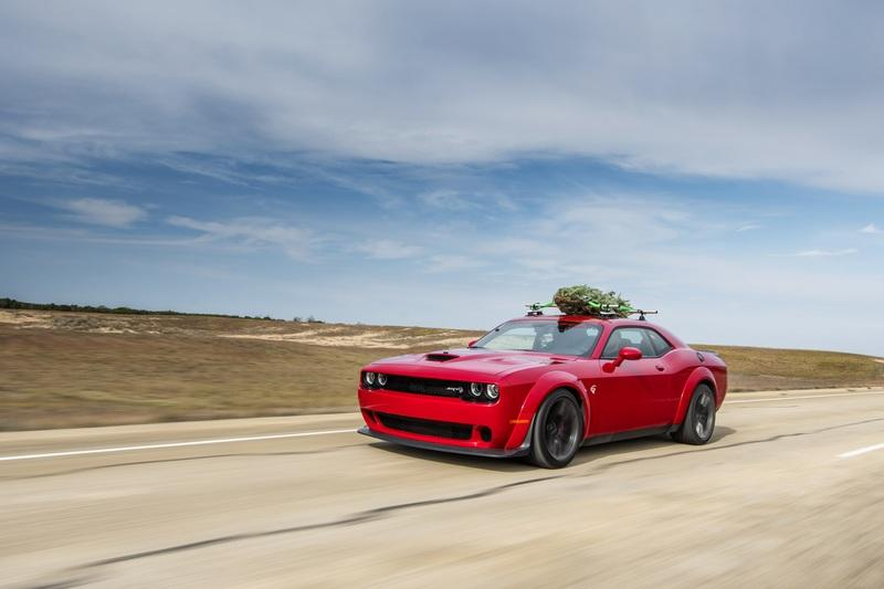 Watch Hennessey Do 174 MPH in a Hellcat Hauling A Christmas Tree!
