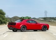 Watch Hennessey Do 174 MPH in a Hellcat Hauling A Christmas Tree! - image 754134