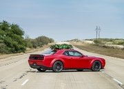 Watch Hennessey Do 174 MPH in a Hellcat Hauling A Christmas Tree! - image 754124