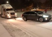 Tesla Model X Pulls Stuck Volvo Semi Out Of The Snow: Video - image 755974