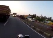 Vide: Rider on an Indian highway miraculously saves himself from an idiot trucker - image 774424