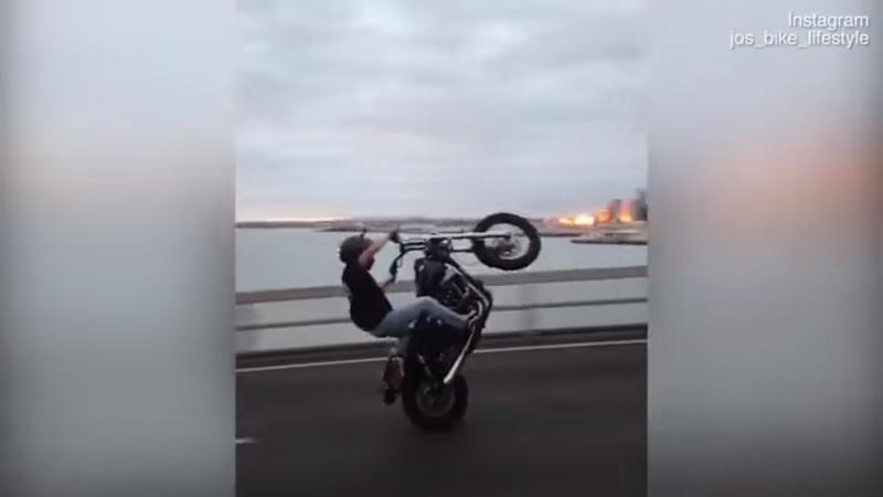 Video: Man does the world first' wheelie across an Auckland bridge