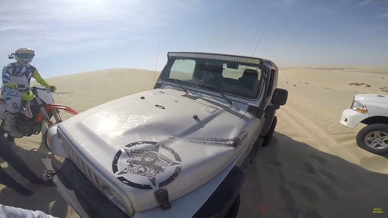 Video: A narrow escape for a motocross rider while dune bashing in Qatar