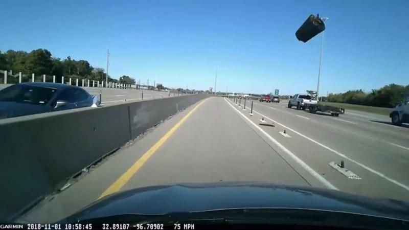 Poorly Secured Trashcan Goes Rogue on the Highway
