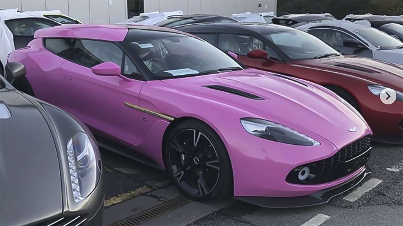 someone has ordered a raging pink aston martin vanquish zagato