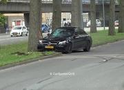 Watch an Idiot in a Mercedes-AMG C63 Go Full On Ford Mustang Into a Tree - image 866724