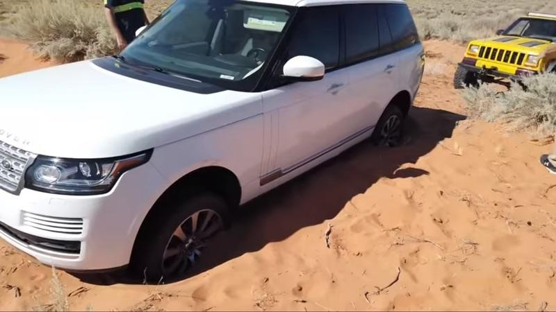 Watch an Old Yellow Jeep Save a Range Rover That's Stuck in the Sand