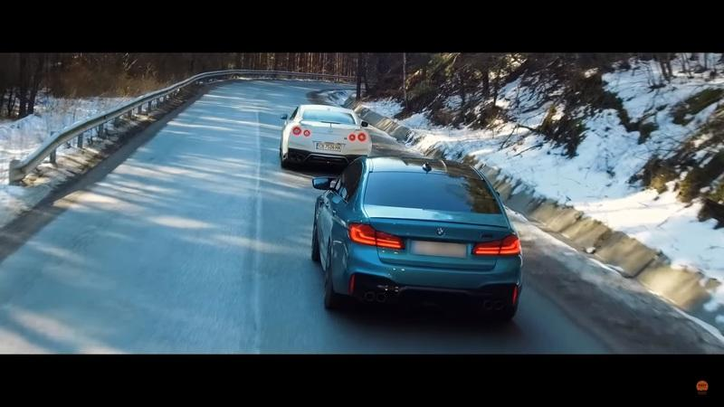 Between Godzilla and the BMW M5, This is One Action-Packed Head-to-Head Showdown