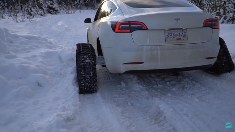 Watch A Tesla Model 3 Equipped With Snowtracks Traverse Over Snow With Ease