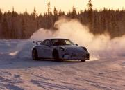 A Porsche 911 GT3 and a Taycan Roll Onto a Frozen Lake - image 907556